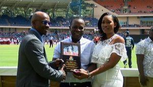 Devon Smith receives plaque